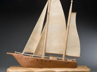 Our designer, Jon Deck, was so impressed with George's sailboat that he set out to make one himself. Jon used redwood for the hull and poplar for the sails.