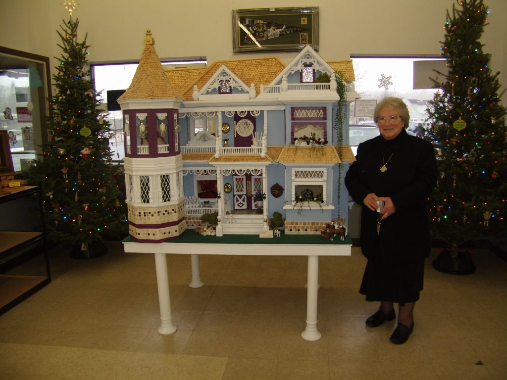 Shirley Wagner customized a basic pattern to build this dollhouse. It stands 4' by 2' by 3', and the roof comprises more than 5,000 shingles.